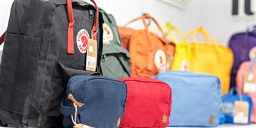 Row of colourful backpacks on display.