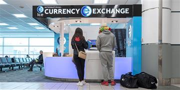 Passengers at International Currency Exchange counter.